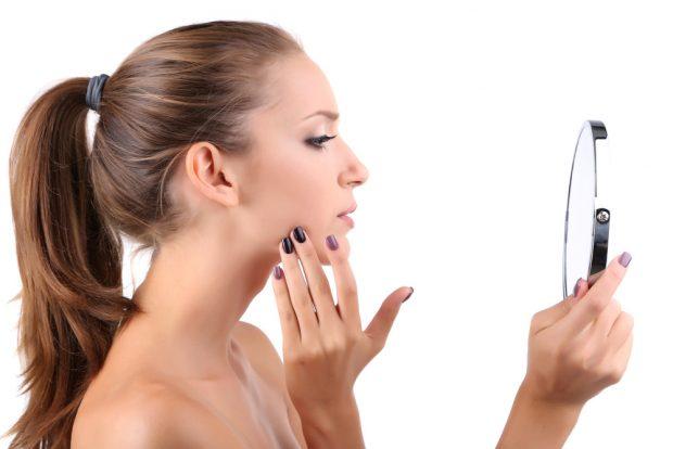 woman holding mirror